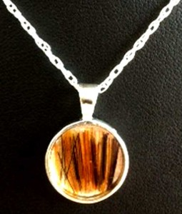 Round horse hair pendant with sterling silver chain.